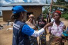 Dr.†Marie-Roseline Darnycka BÈlizaire, World Health Organisation (WHO) Epidemiology Team Lead, talks to women as part of Ebola contact tracing, in Mangina, Democratic Republic of Congo August 26, 2018. Picture taken August 26, 2018.   WHO/Junior Kannah/Handout via REUTERS ATTENTION EDITORS - THIS IMAGE HAS BEEN SUPPLIED BY A THIRD PARTY. - RC1AE1BC5700